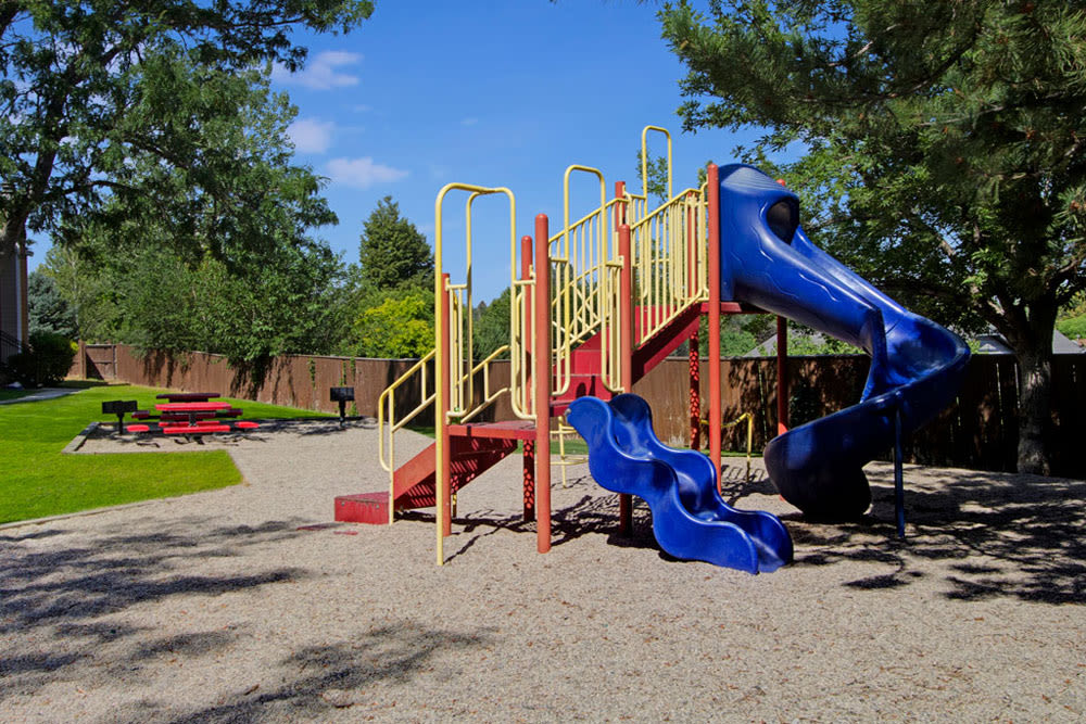 Children's playground outside at Overlook Point Apartments in Salt Lake City, Utah