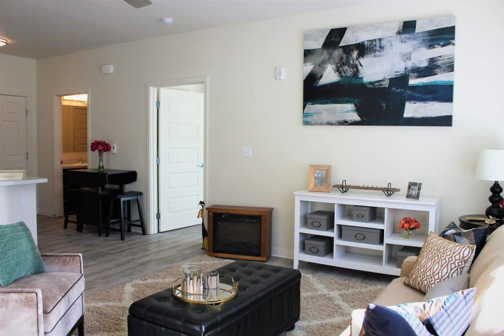 Well decorated model living room at LARC at Burien in Burien, Washington