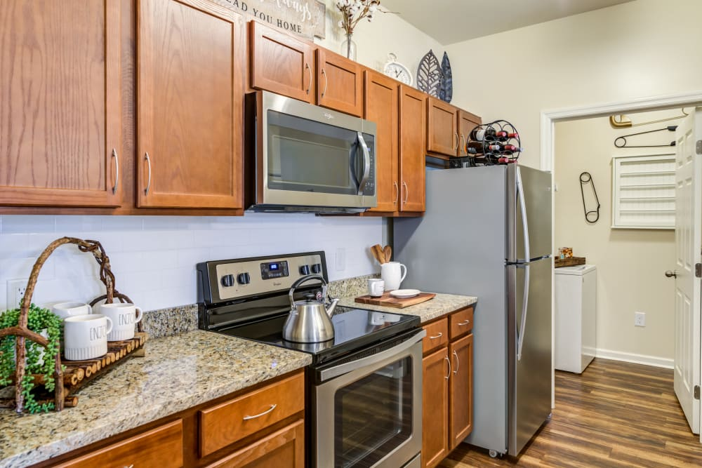 Kitchen with stainless steel appliances at Commonwealth at 31 in Spring Hill, Tennessee
