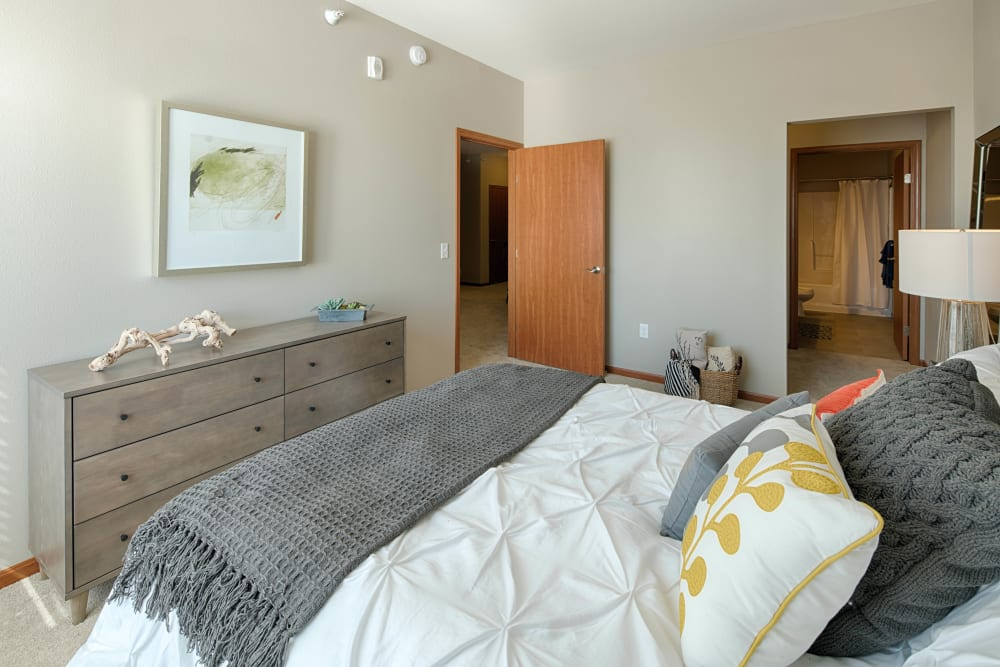 Bedroom with a master bathroom at Remington Cove Apartments in Apple Valley, Minnesota