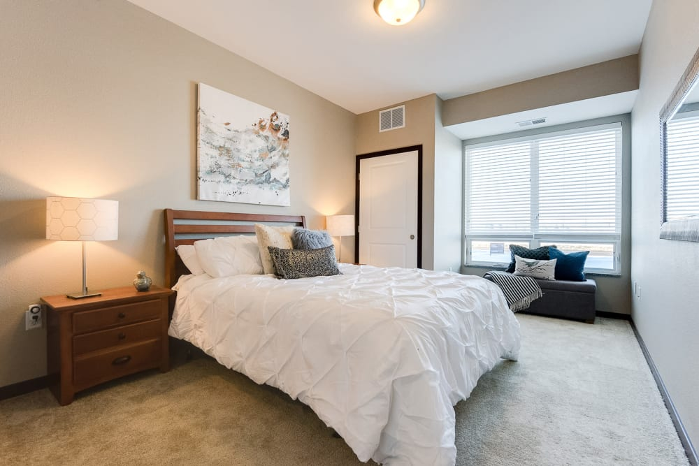 Very spacious main bedroom with a floor-to-wall window at Remington Cove Apartments in Apple Valley, Minnesota