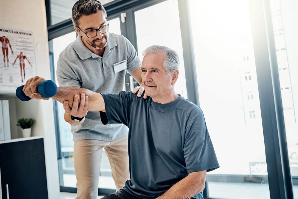 Instructor assisting a resident in strength training at Edencrest at Siena Hills in Ankeny, Iowa