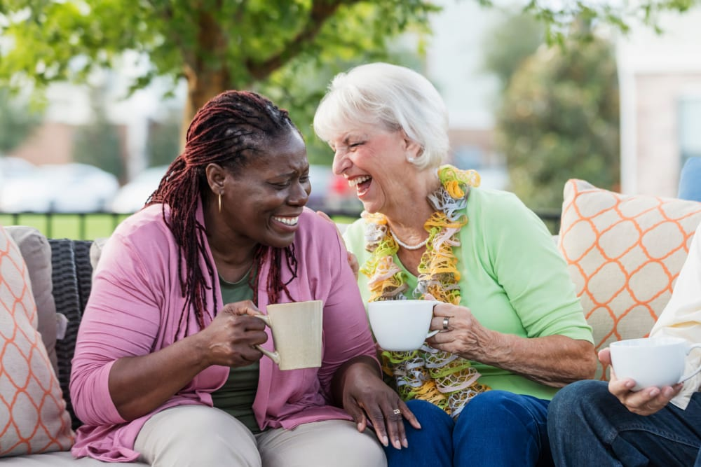Residents drinking coffee outside talking at Edencrest at Siena Hills in Ankeny, Iowa