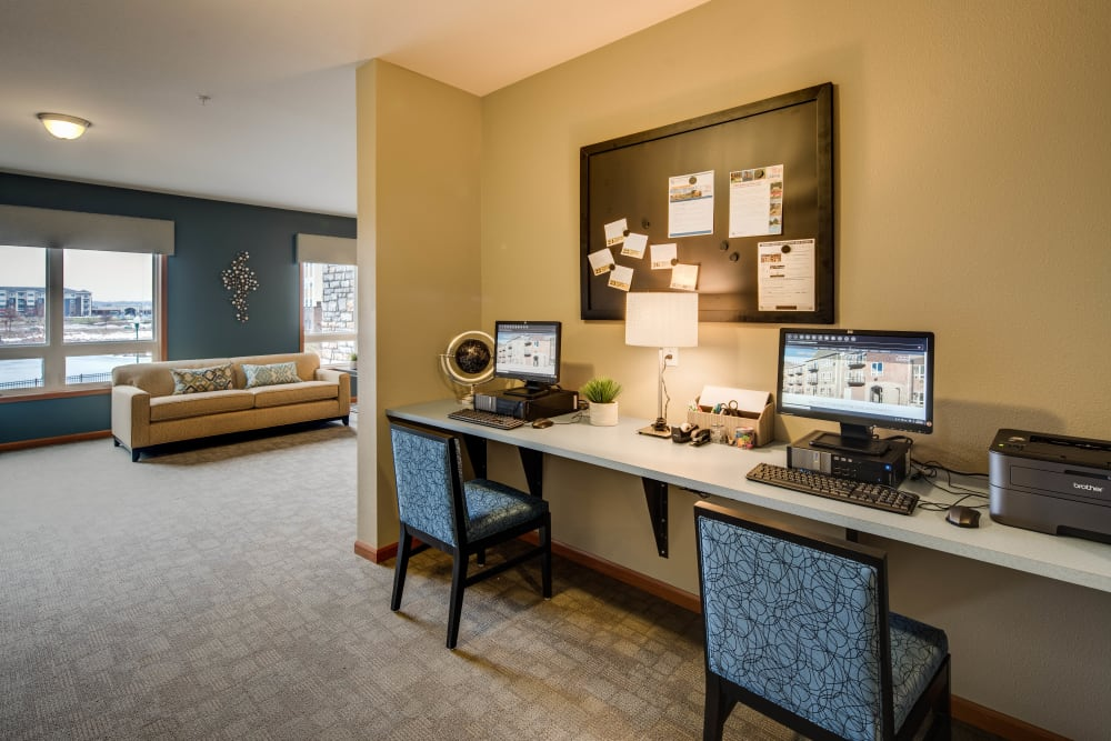 Business center with individual computers for resident use at Remington Cove Apartments in Apple Valley, Minnesota