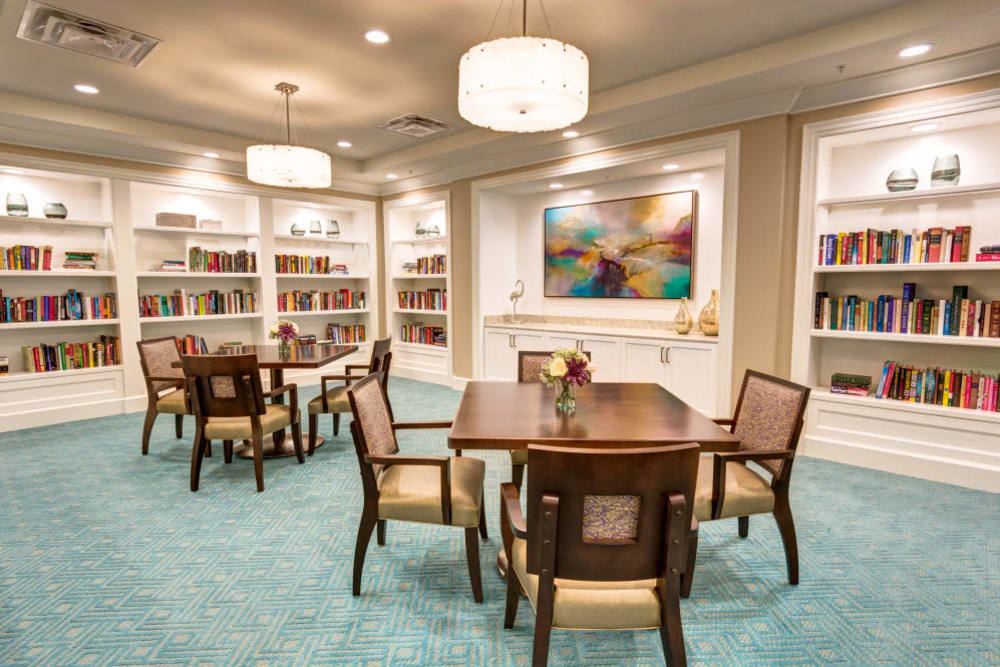 Activity Room with seating and reading table at Symphony at Delray Beach in Delray Beach, Florida