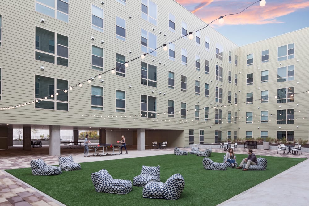 Courtyard with games like cornhole at LATITUDE in Lincoln, Nebraska