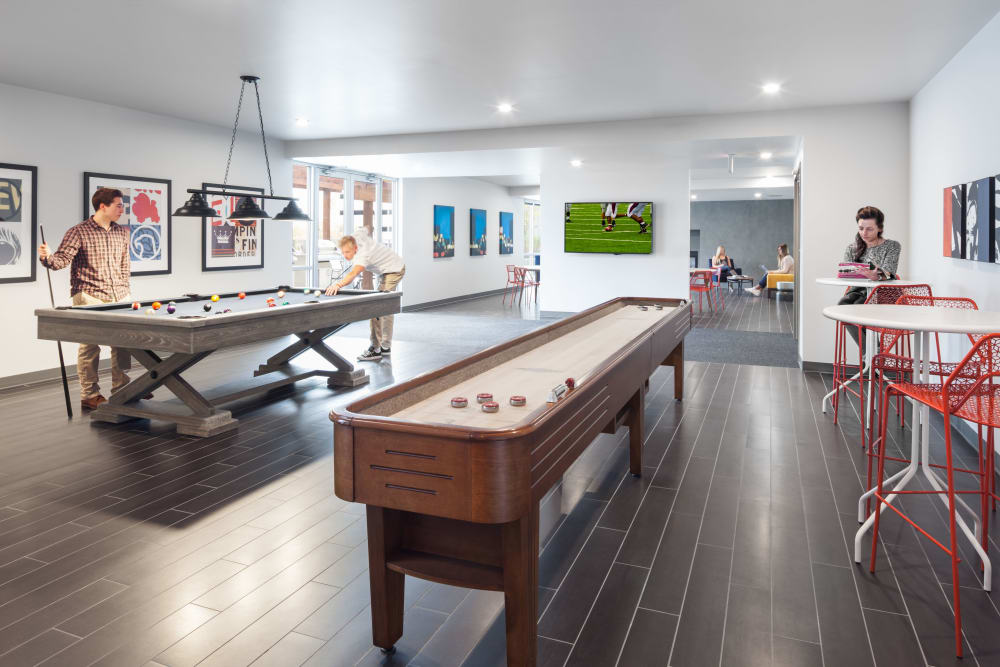 Community game room at LATITUDE in Lincoln, Nebraska