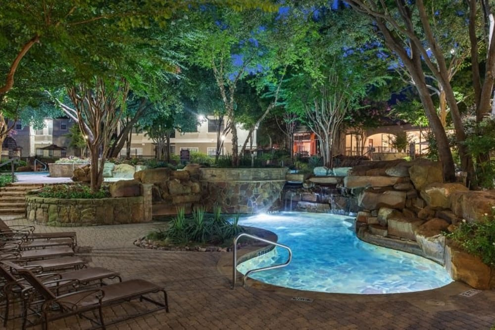 Sparkling pool at night at The Verandas at Timberglen in Dallas, Texas