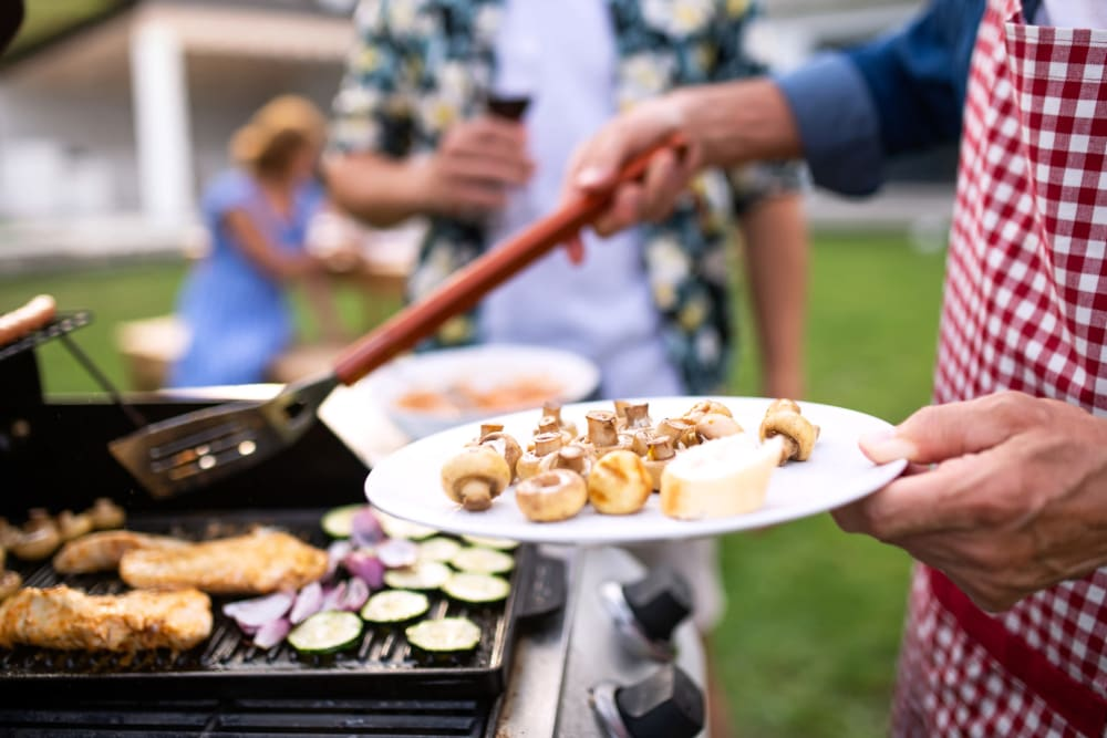 Resident barbequing food at Remington Cove Apartments in Apple Valley, Minnesota