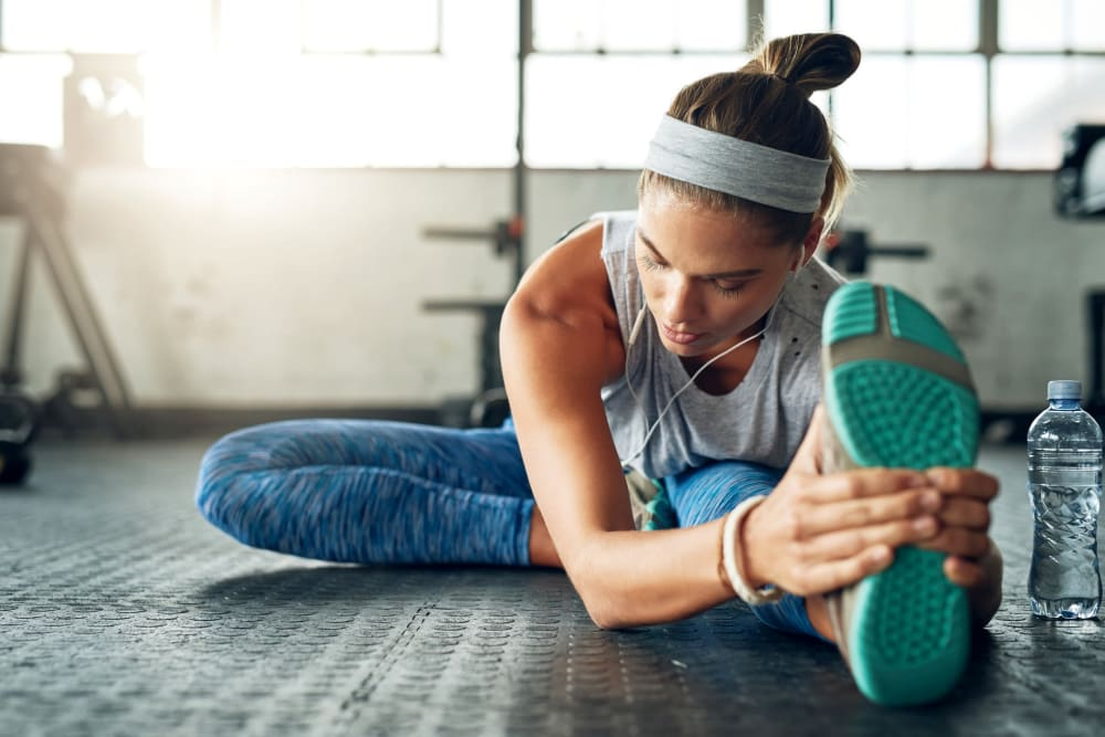 Resident stretching at her community gym at Remington Cove Apartments in Apple Valley, Minnesota