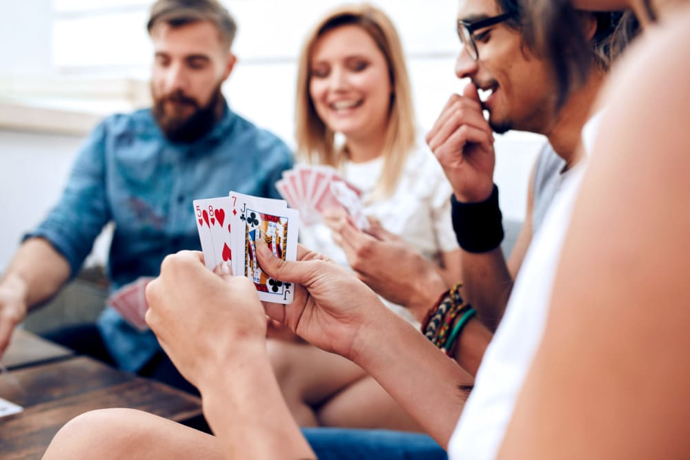 Residents playing games in their new home at Remington Cove Apartments in Apple Valley, Minnesota