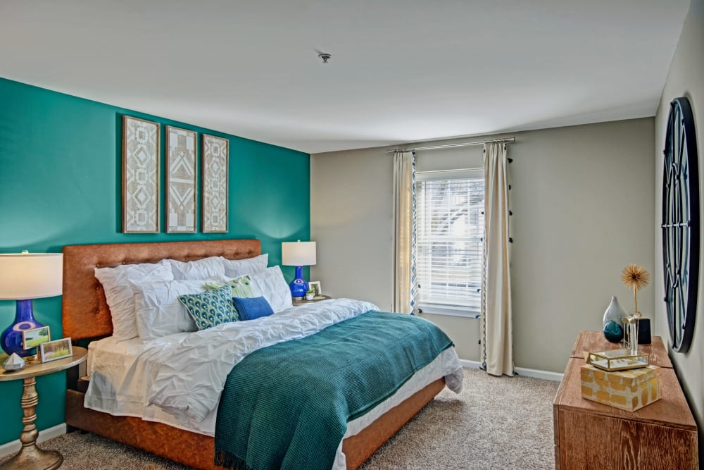 Bedroom showcasing green walls and lots of natural light at Exton Crossing in Exton, Pennsylvania