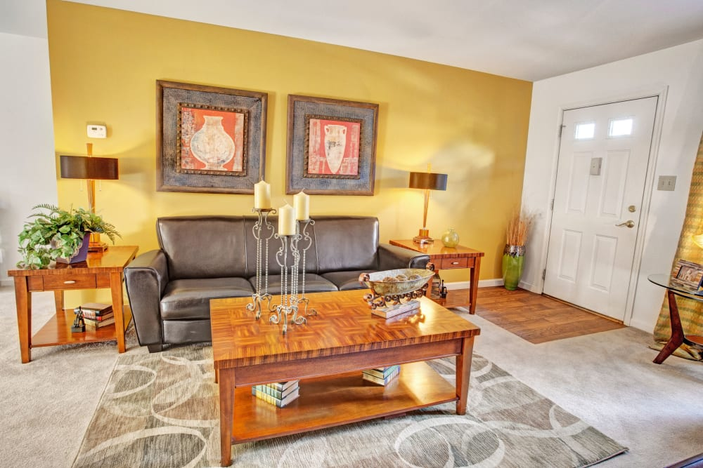 Living room with yellow walls at Exton Crossing in Exton, Pennsylvania