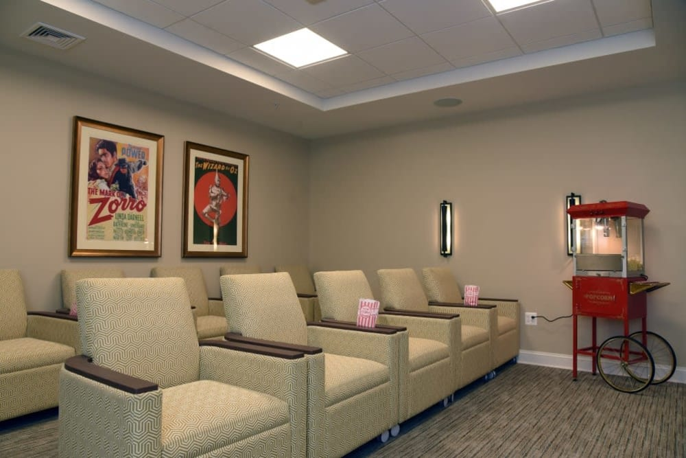 Ample seating in movie room at Symphony at Cherry Hill in Cherry Hill, New Jersey