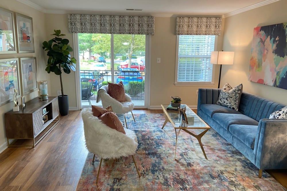 Spacious living room at Abbotts Run Apartments in Alexandria, Virginia.