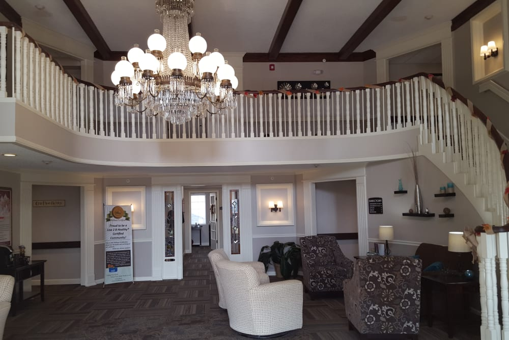 Main lobby area with stairs leading to the second floor at Brown Deer Place in Coralville, Iowa