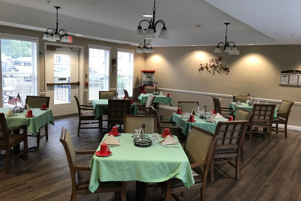Dining room with large windows and spread-out tables at Brown Deer Place in Coralville, Iowa