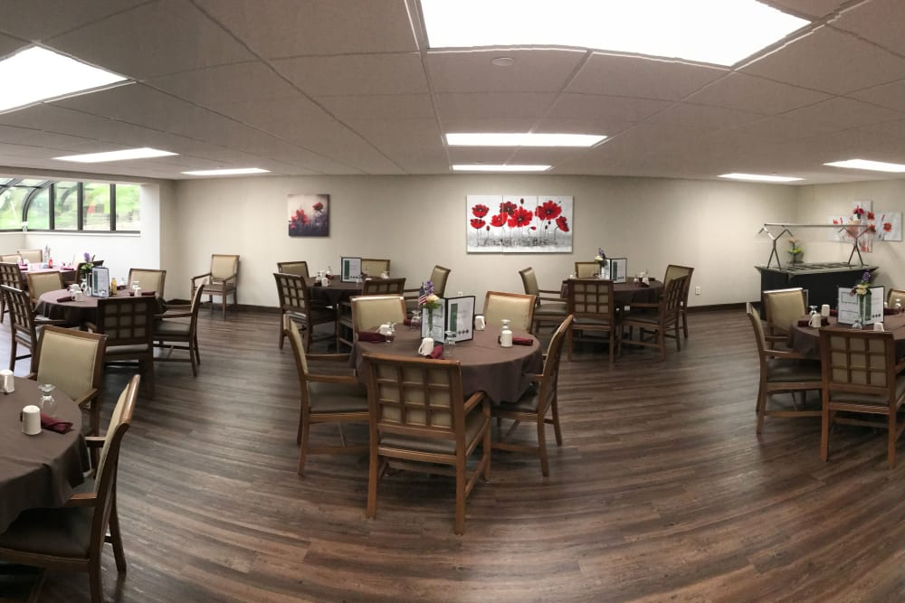 Dining room with dark hardwood floors and lots of space at Brown Deer Place in Coralville, Iowa