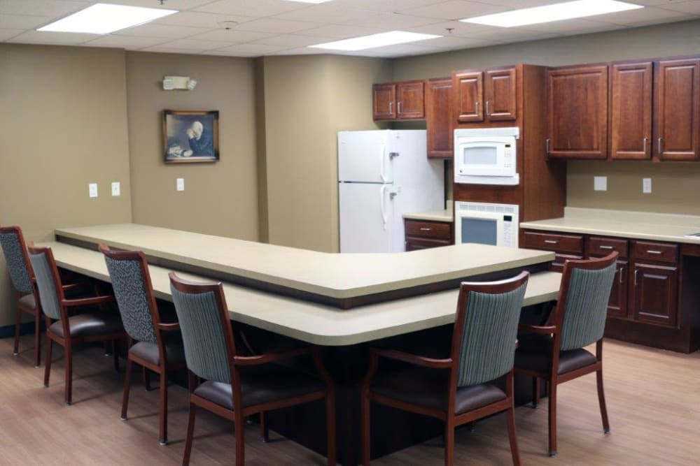 Community kitchen with a serving bar and seating at Keelson Harbour in Spirit Lake, Iowa
