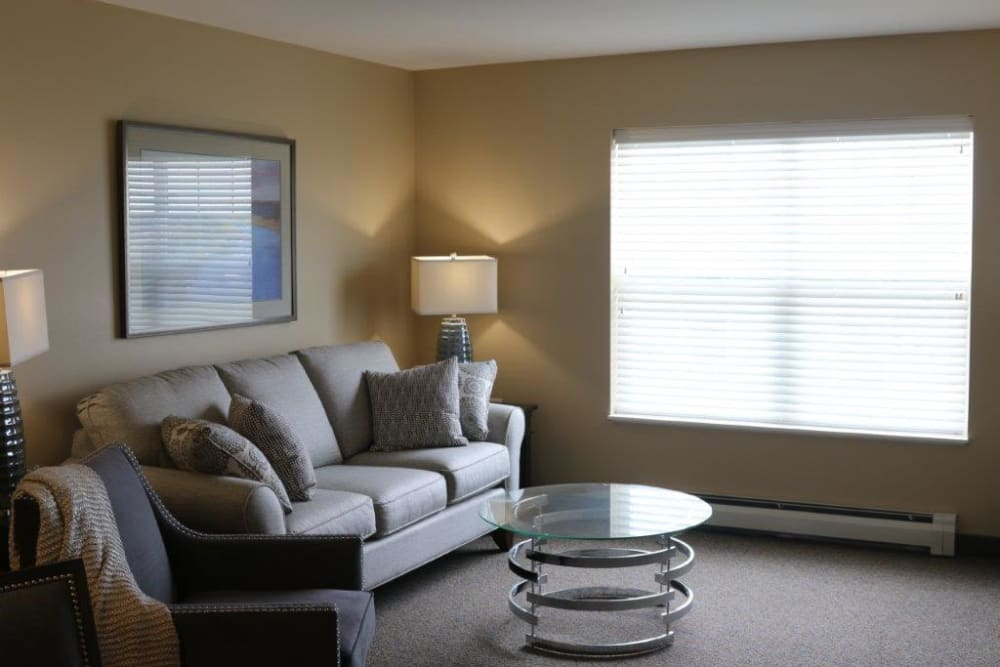 Sunlit senior apartment living room at Keelson Harbour in Spirit Lake, Iowa