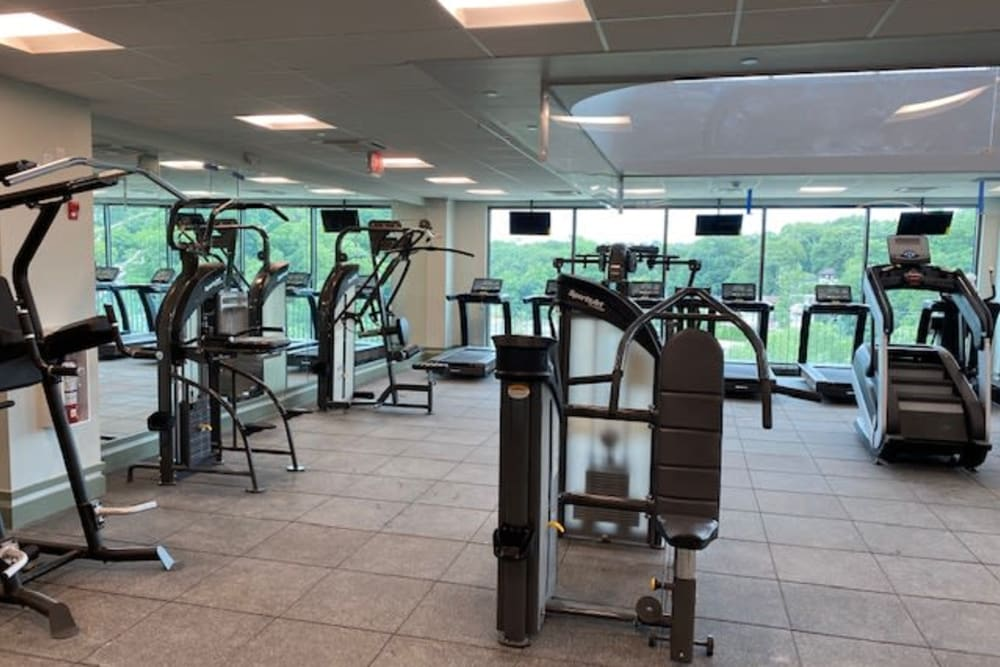Large fitness center with big windows at Monarch at Ridge Hill in Yonkers, New York