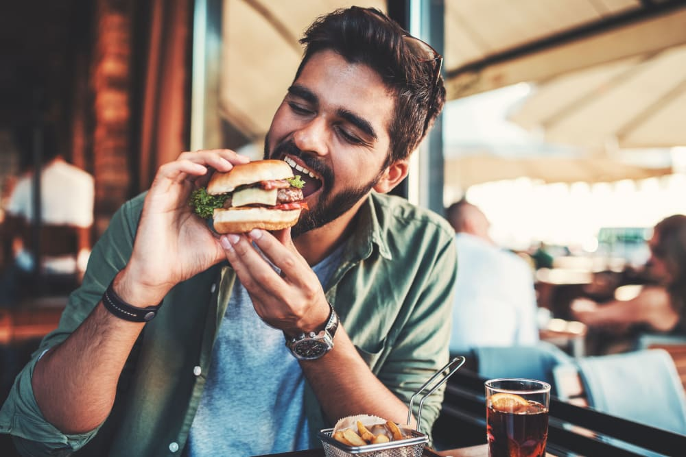 Resident enjoying a burger near Arc at Old Colony in Chicago, Illinois