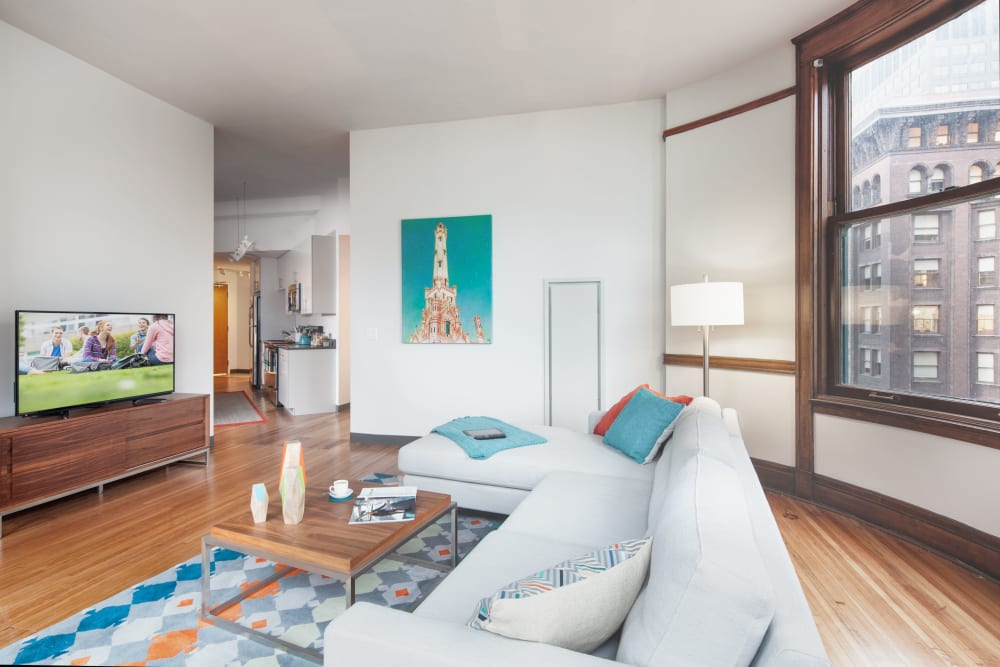 Bright, spacious living room at Arc at Old Colony in Chicago, Illinois