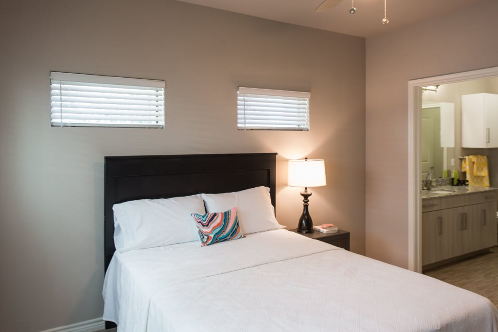 Bright, cozy bedroom at Texan 26 in Austin, Texas