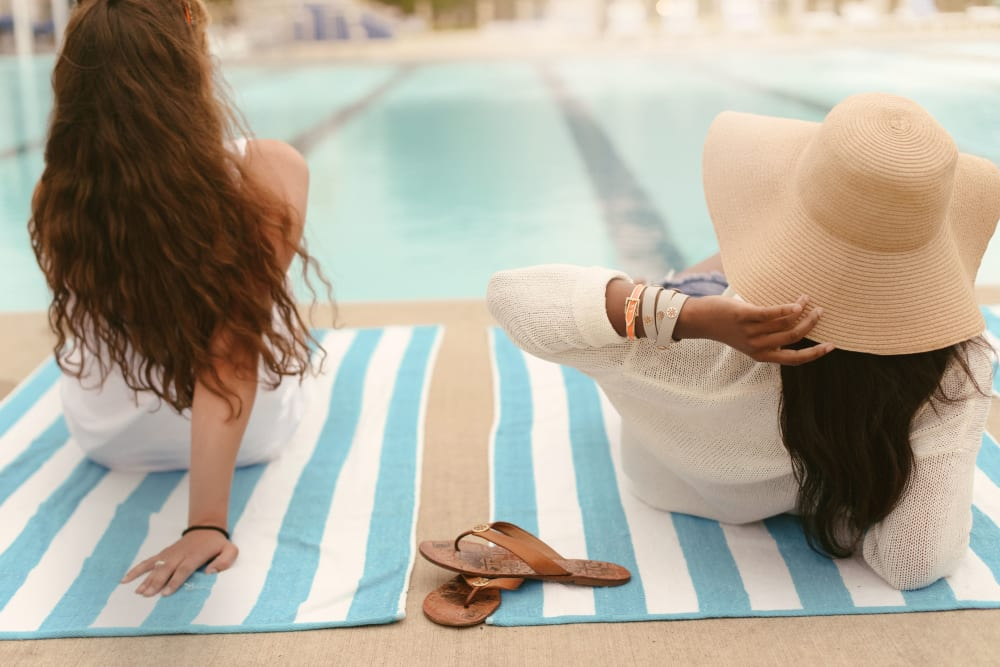 Resident relaxing by the pool at West Quad in Champaign, Illinois