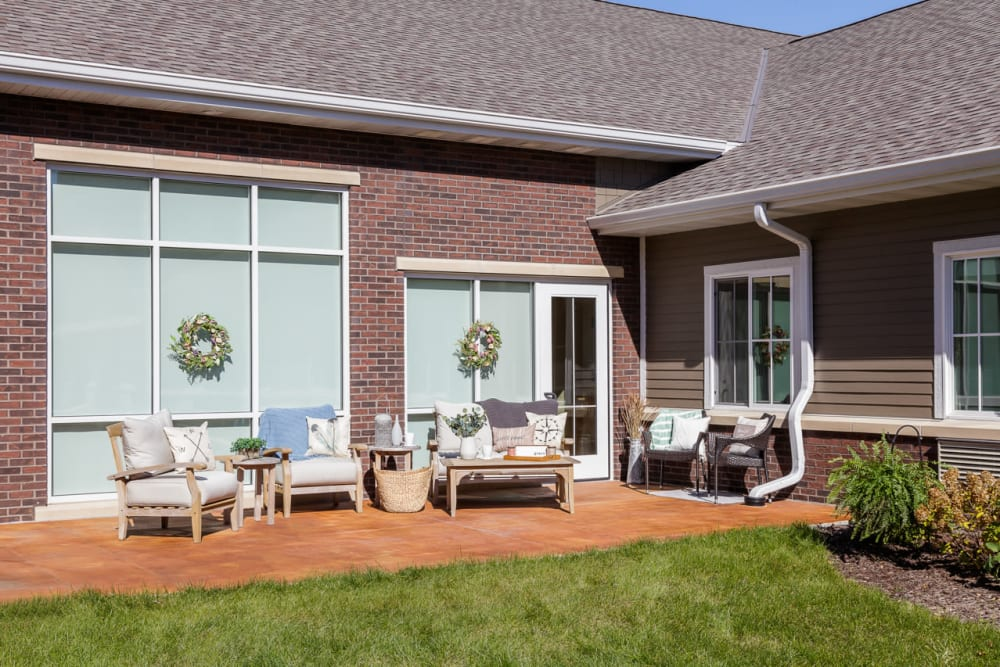 Sunlit patio seating outside Edencrest at Siena Hills in Ankeny, Iowa