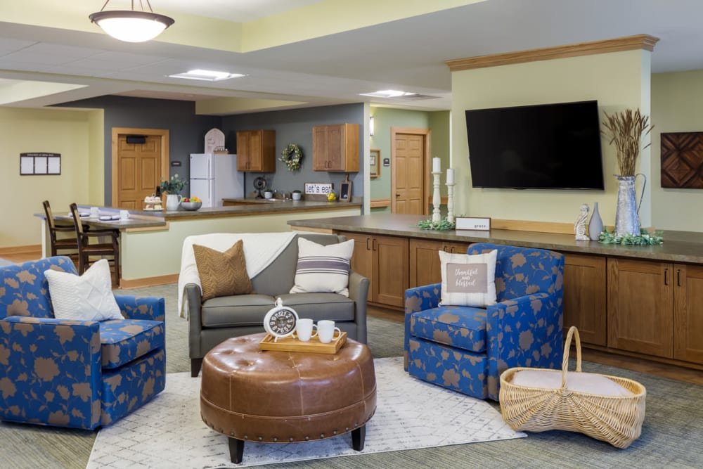Senior lounge with a tv, snack bar, and lots of seating at Edencrest at Siena Hills in Ankeny, Iowa