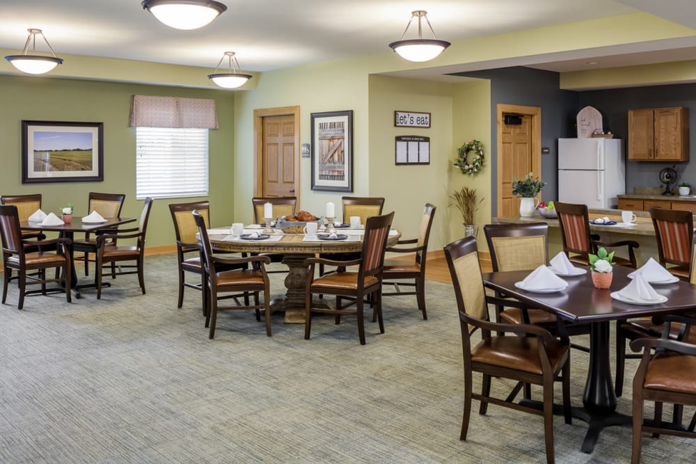 Dining room with lots of spaced out tables at Edencrest at Siena Hills in Ankeny, Iowa