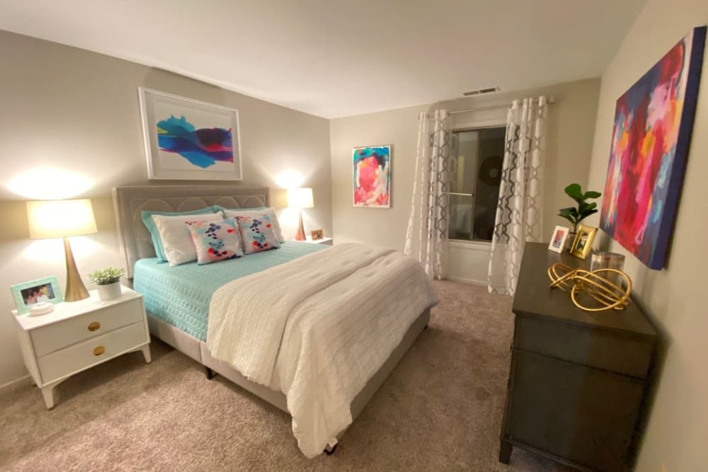 Bedroom in a model home at The Timbers at Long Reach Apartments in Columbia, Maryland