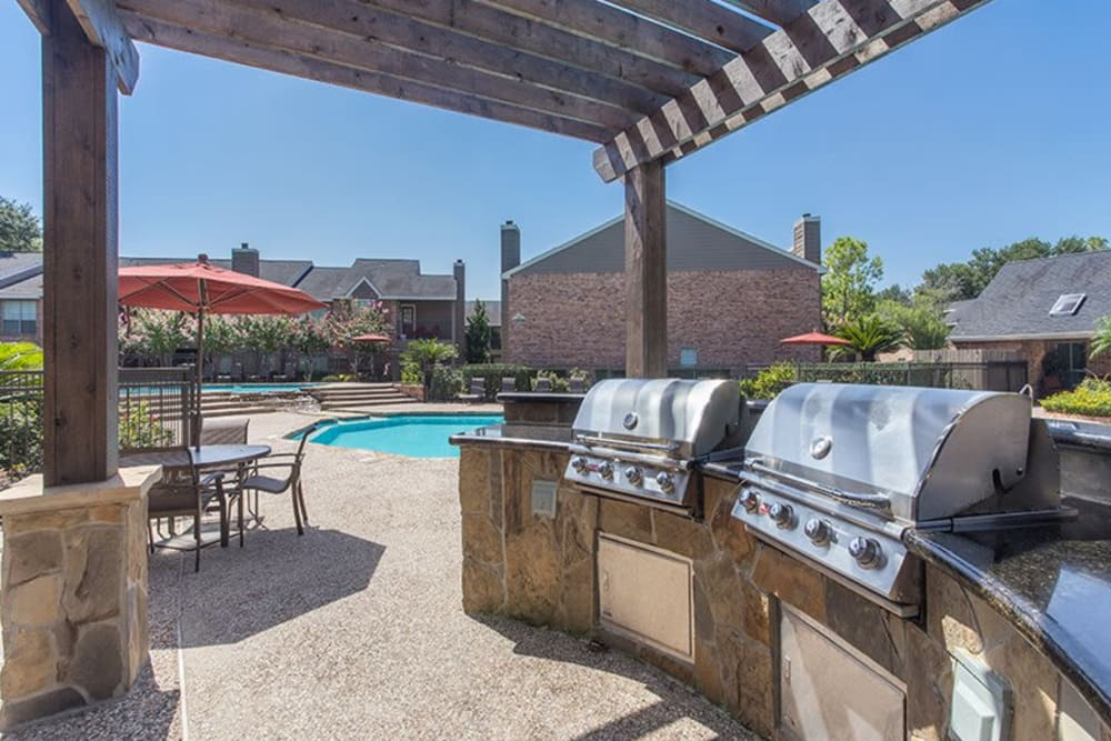 BBQ patio by pool at Broadstone Briar Forest in Houston, Texas