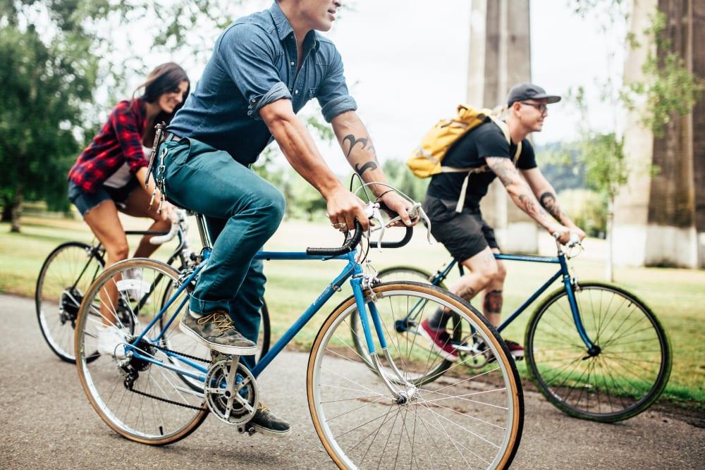 Resident friends biking through Irving Park near Ascend in Portland, Oregon