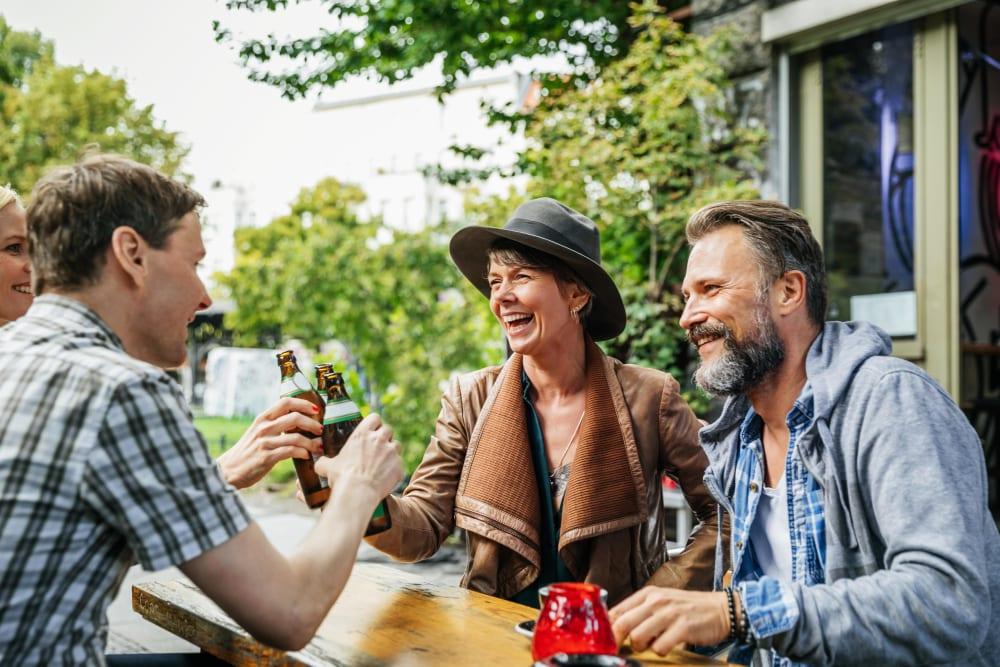 Resident friends sitting outside enjoying drinks at their favorite bar near Ascend in Portland, Oregon