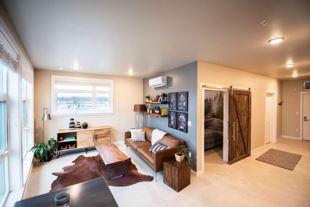 Well-furnished model home's living space at Brooklyn Yard in Portland, Oregon