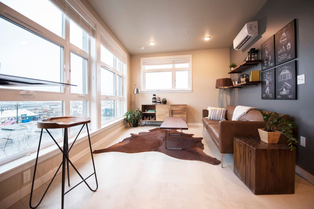 Large bay windows providing an incredible city view from a model home's living space at Brooklyn Yard in Portland, Oregon