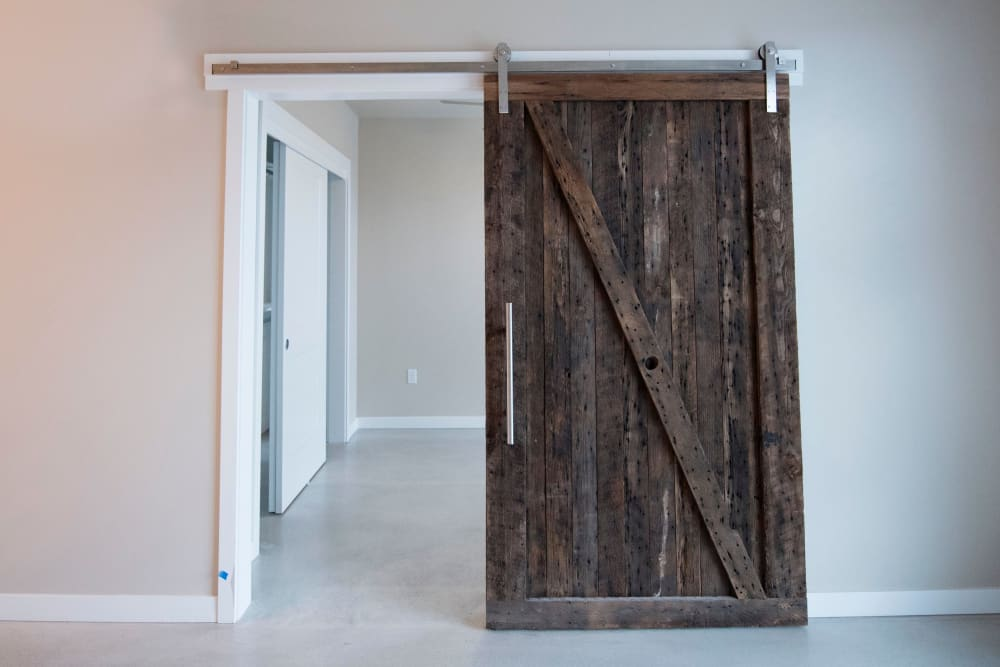 Reclaimed barn-wood door in a model home at Brooklyn Yard in Portland, Oregon