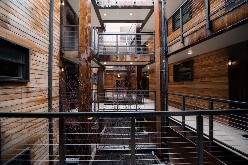 Rustic reclaimed wood siding throughout the community common areas at Brooklyn Yard in Portland, Oregon