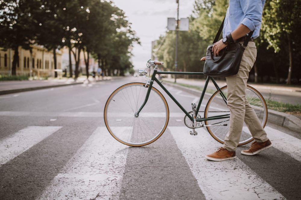 Resident walking his bike to school in Philadelphia, Pennsylvania near The Link University City
