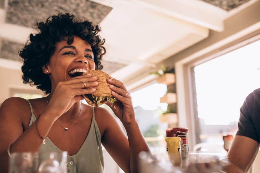 Resident eating a burger in Austin, Texas near Texan 26