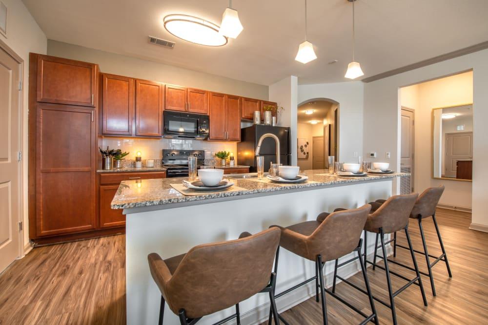 Model kitchen with dark wood at Olympus Katy Ranch in Katy, Texas
