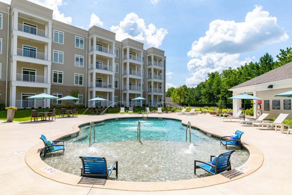 Resort-style swimming pool area set against a beautiful sky at The Station at River Crossing in Macon, Georgia