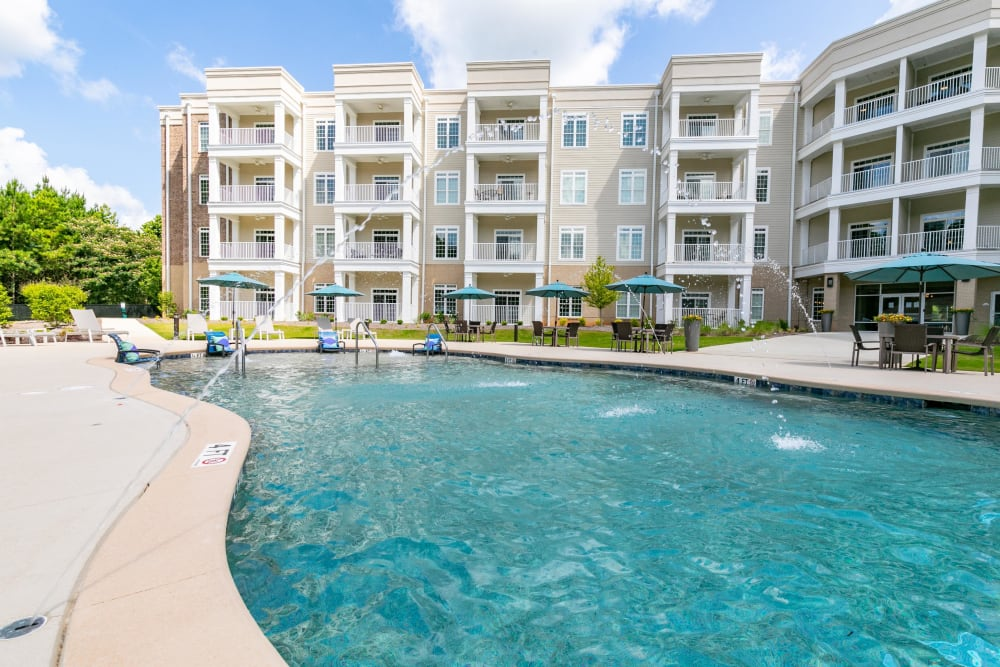 Resort-style swimming pool with fountains at The Station at River Crossing in Macon, Georgia