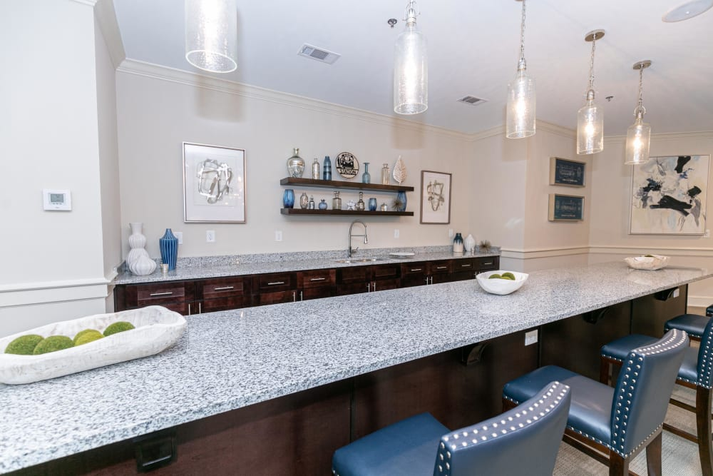 Bar area in the resident clubhouse lounge at The Station at River Crossing in Macon, Georgia