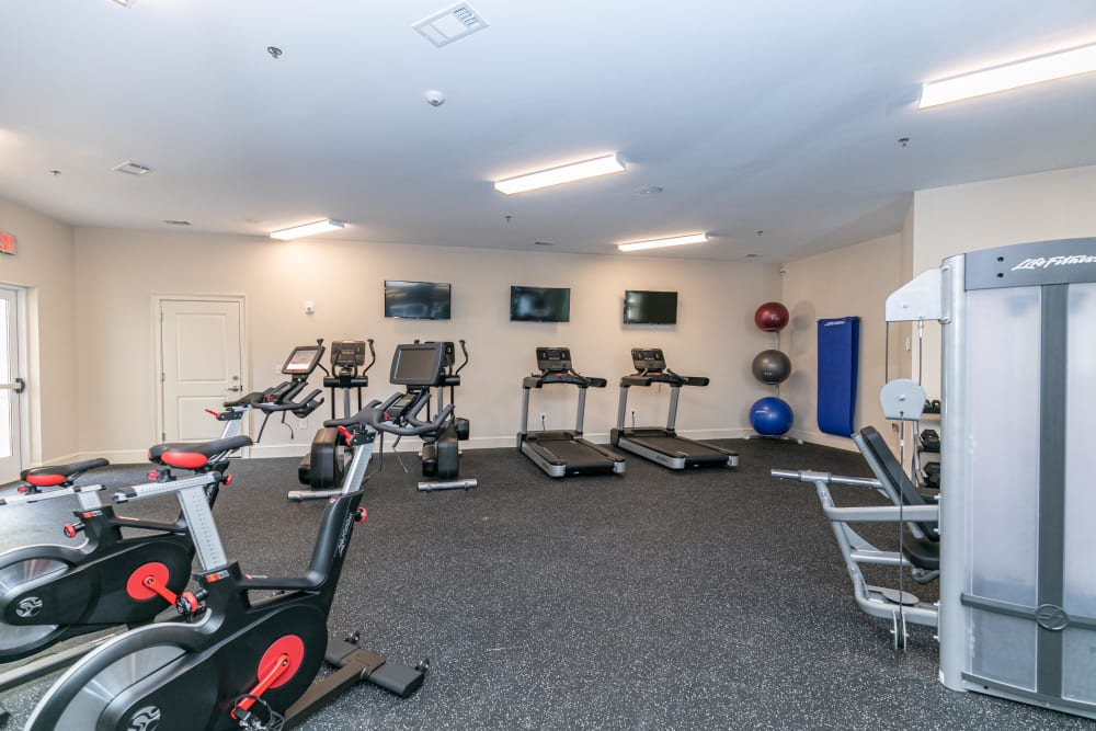 Well-equipped onsite fitness center at The Station at River Crossing in Macon, Georgia
