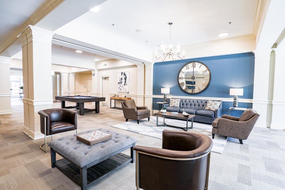 Resident clubhouse game room and lounge at The Station at River Crossing in Macon, Georgia