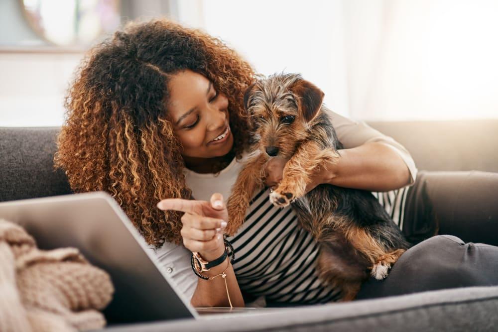 Student resident and her dog looking at a computer at HERE Atlanta in Atlanta, Georgia