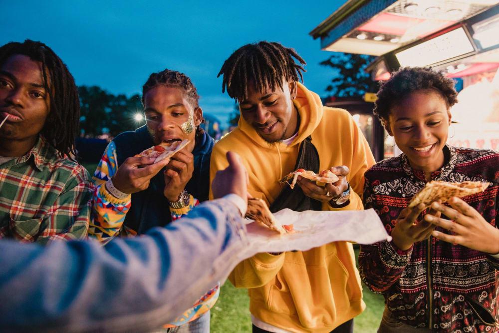 Friends enjoying food from a food truck near HERE Atlanta student apartments in Atlanta, Georgia